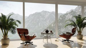 Office with ceiling to floor double glazing windows looking out to mountains.