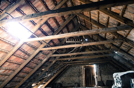 View of bare wooden loft ceiling before loft insulation is installed